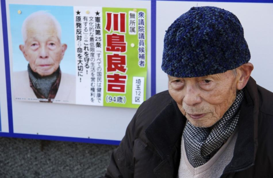 Ryokichi Kawashima, a 94-year-old parliamentary election candidate, speaks in front of his...
