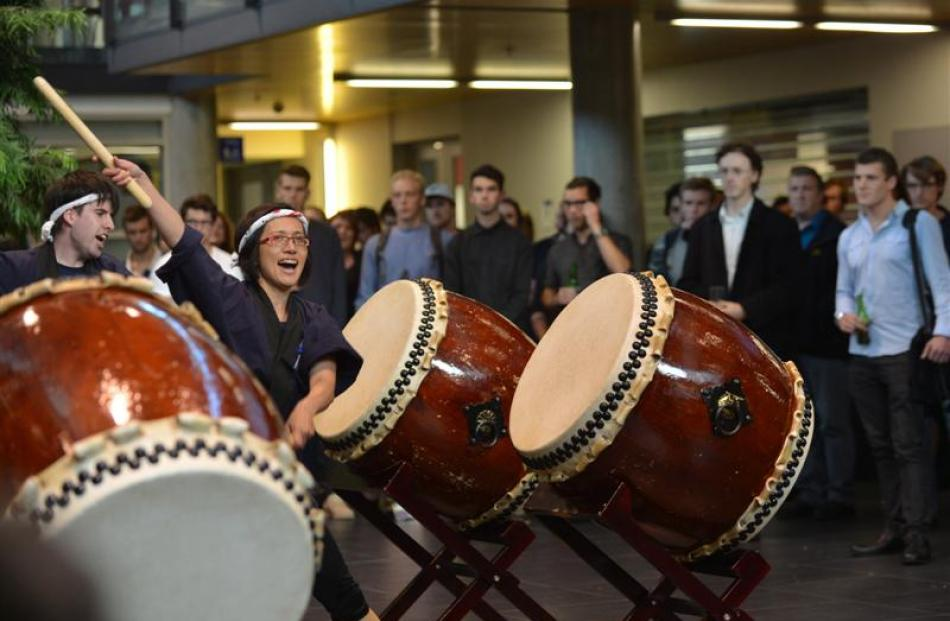 Ryoko de Burgh-Hirabe plays the drums during the launch of this year's Audacious business...