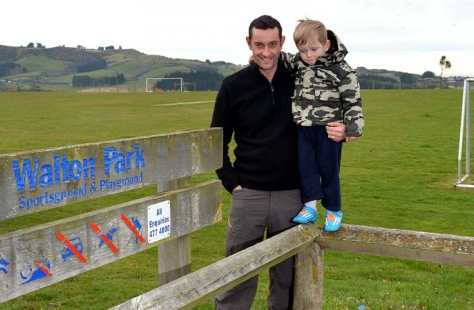 Saddle Hill Community Board chairman Scott Weatherall with son George (2) at Walton Park ain...