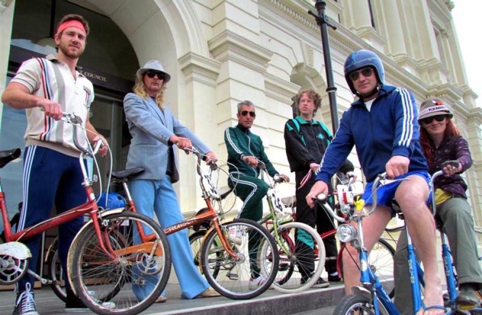 Safari Brothers Cycle Club members, back, from left,  Nick Lynch-Watson,   Mick Shuffler, Dave...