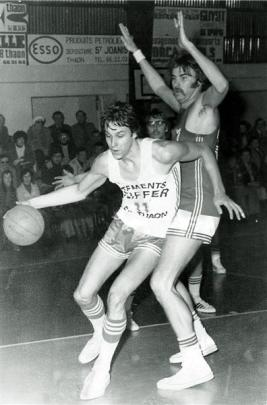 Saker driving past American Paul Ellis at a French league game in the Thaon-Les-Vosges gym in the...