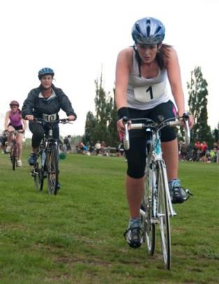 Samantha Lindley leads Maree Cowan out of transition in last year's event. Photos supplied.