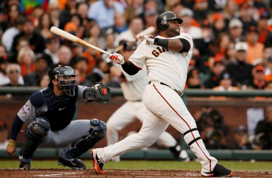 San Francisco Giants' Pablo Sandoval (R) hits a solo home run in front of Detroit Tigers catcher...
