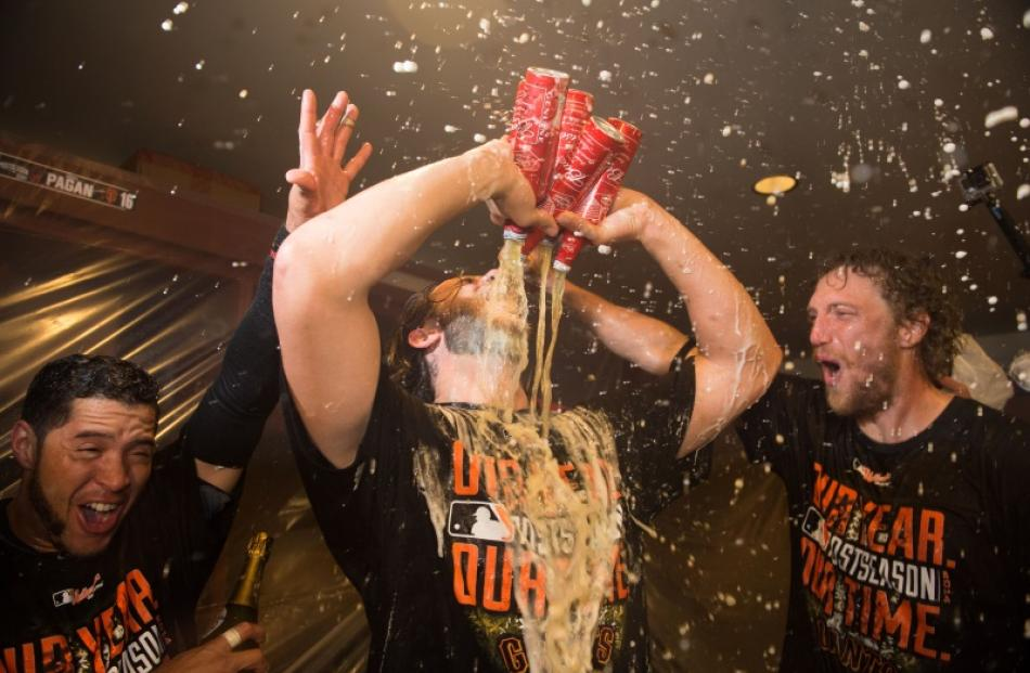 San Francisco Giants starting pitcher Madison Bumgarner (40, centre) celebrates with center...