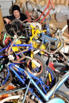 Scott Eady, photographed in 2012 with leftover bikes from his 100-bike installation which was...
