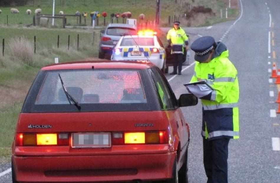 Senior Constable Emma Fleming speaks to a motorist early this morning as part of a police canvas...