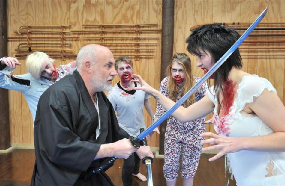 Sensei Phil Davison battles zombies Sarah Williamson (foreground) and (from left) Charlotte...