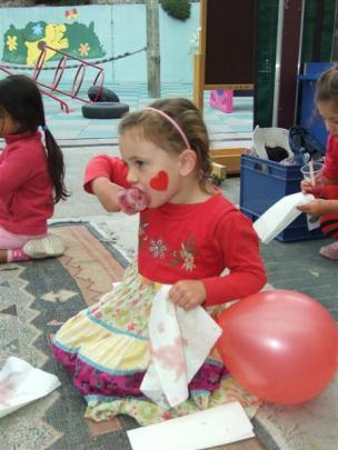 Seren Blair (4) enjoy a Valentine's Day-inspired ice block.