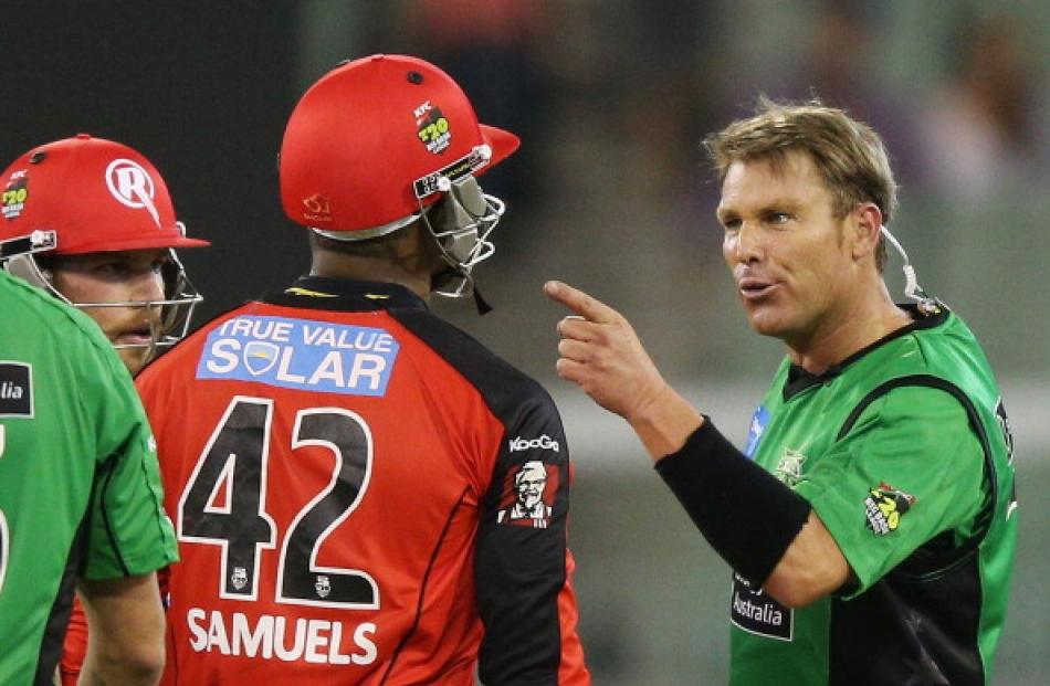 Shane Warne (R) of the Melbourne Stars has a heated exchange with Marlon Samuels of the Melbourne...