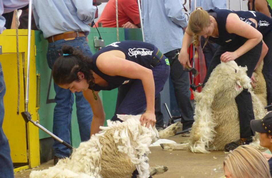 Shearers Kelly Macdonald (left), of Hawera, and Sarah Higgins, of Havelock, go all out in the...