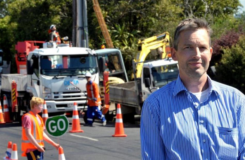 Shiel Hill, Dunedin, resident Lars Grau worries yesterday's power outage, caused by work to...