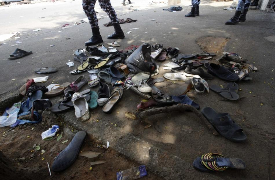 Shoes are seen along a street in Plateau district where a stampede occurred after a New Year's...