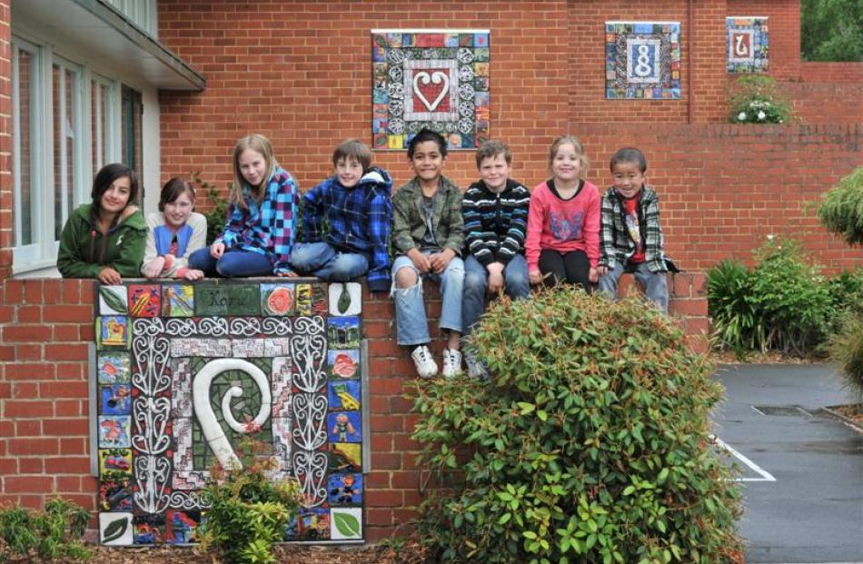 Showing off the new mosaic murals at Bradford School yesterday are (from left) Reyana Barringer...