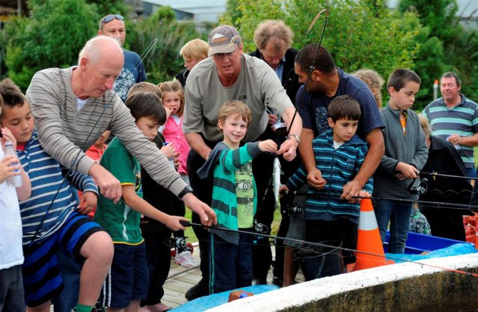 Showing the adults how it is done at the New Zealand Salmon Anglers Association Otago open day...