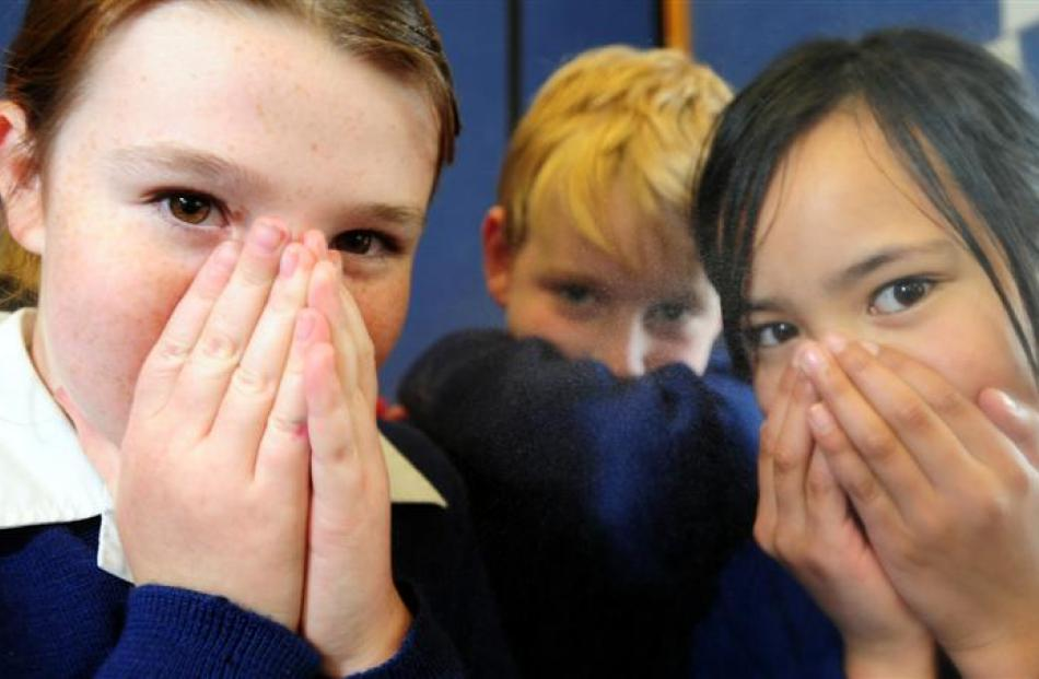 Showing the art of safe sneezing are St Joseph's School (Dunedin) pupils (from left) Lily...