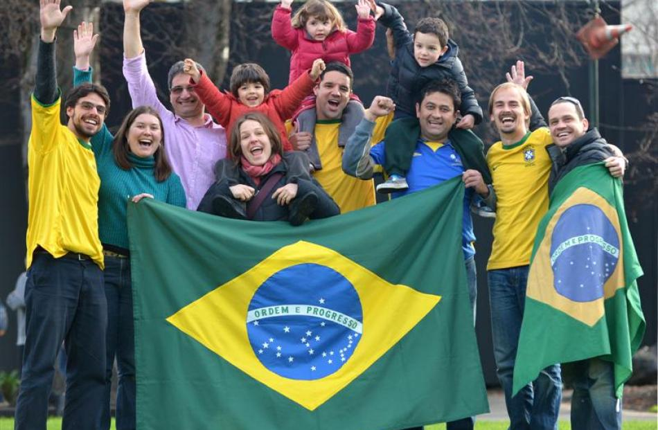 Showing their colours in Dunedin yesterday are Brazilian football fans (from left) Marcelo Castro...
