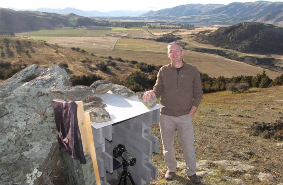 Simon Larkin with the small bird hide he built on his property high in the Queensberry hills to...