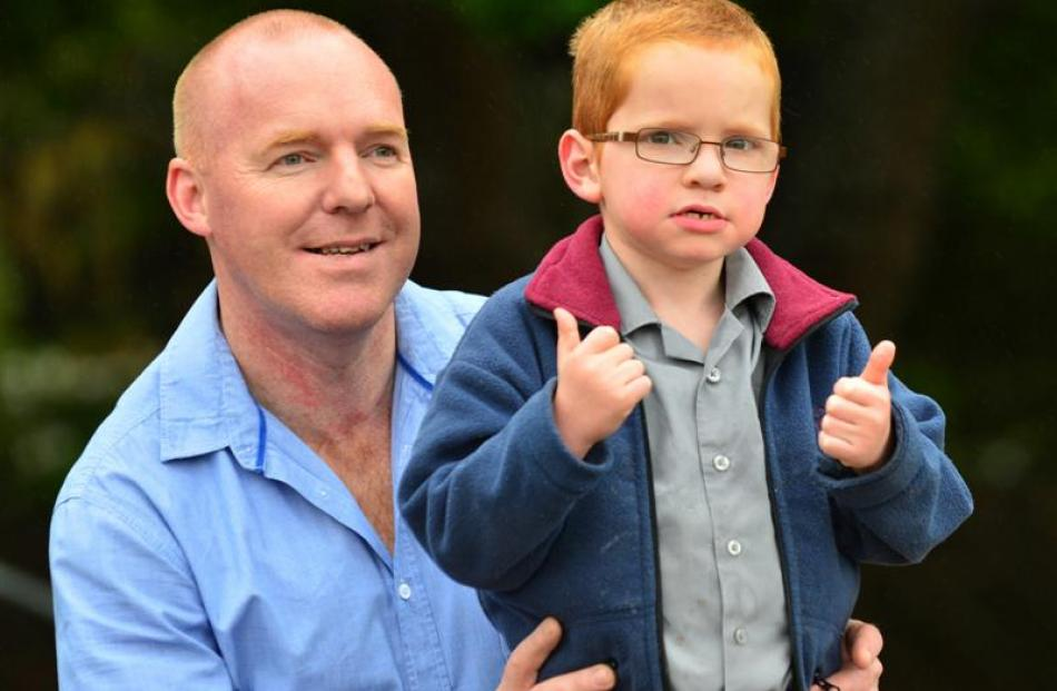 Sinclair May, with father Jason, gives the thumbs up yesterday. Photo by Peter McIntosh.