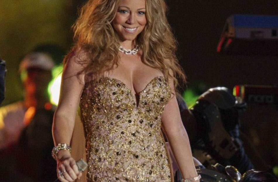 Singer Mariah Carey smiles after performing during the 2012 NFL kickoff show in New York. REUTERS...