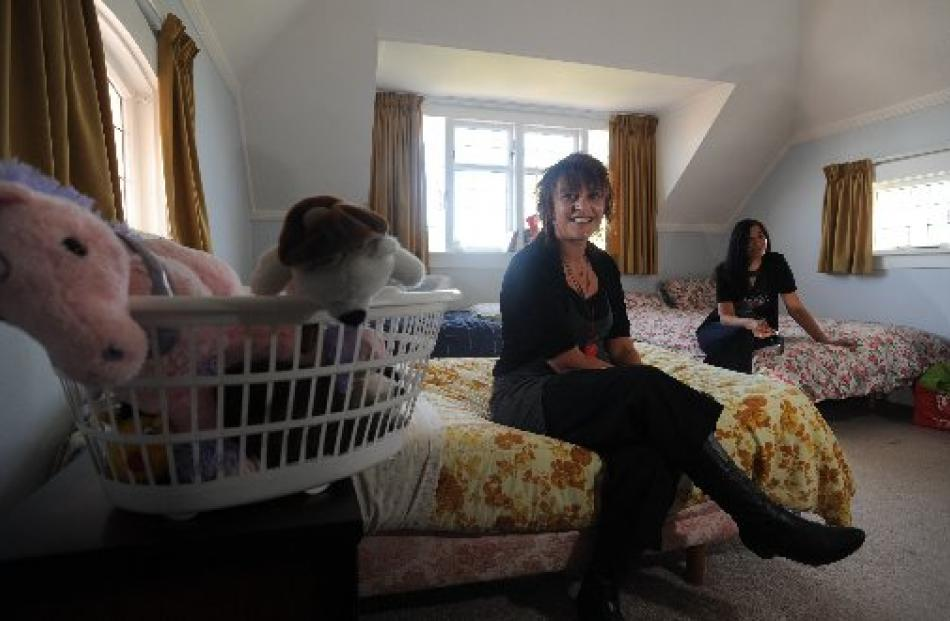 Sitting in a family room in one of Te Whare Pounamu Dunedin Women's Refuge safe houses are...