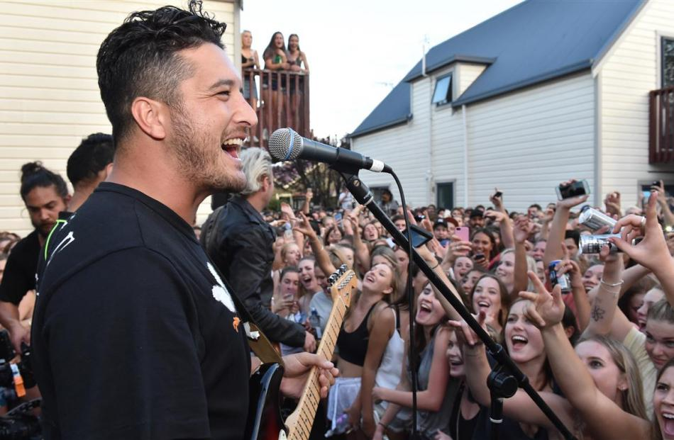 Six60 singer Matiu Walters entertains the crowd after the balcony collapse. Photos by Gregor...
