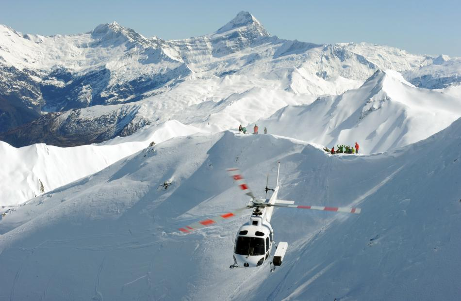 Skiers are dropped off on a ridge line by helicopter. Supplied photo.