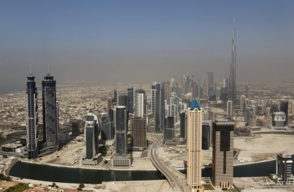 Skyscrapers are seen with the Burj Khalifa (at right), the tallest tower in the world at a height...