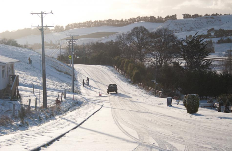 Snow made for quiet roads in Waikouaiti this morning. Photo Rob Mackintosh