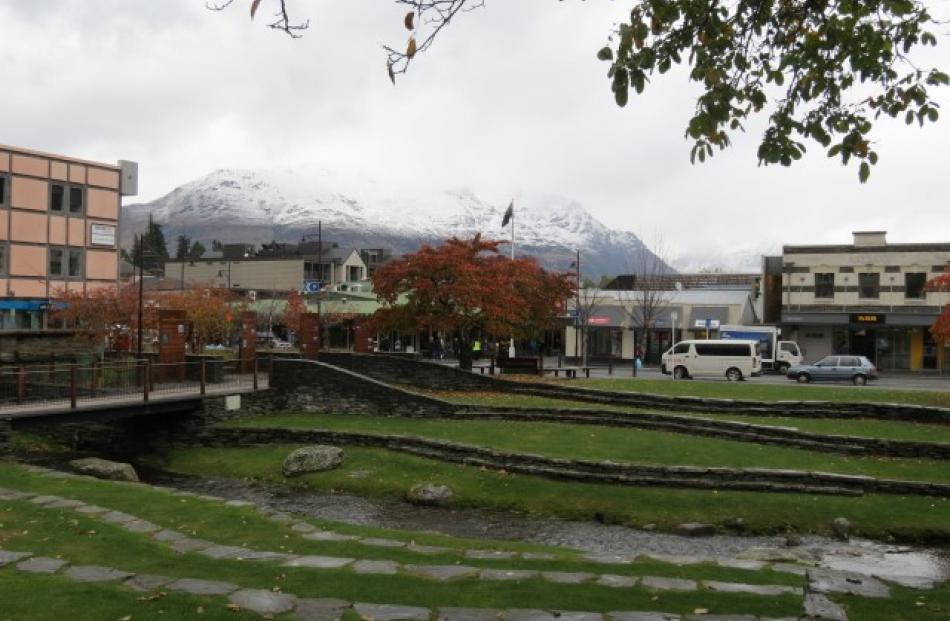 Snow on the hills is making for a cool day in Queenstown today. Photo James Beech