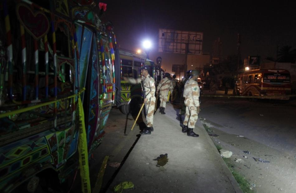 Soldiers cordon off the site of a motorcycle bomb blast in Karachi. Photo by Reuters