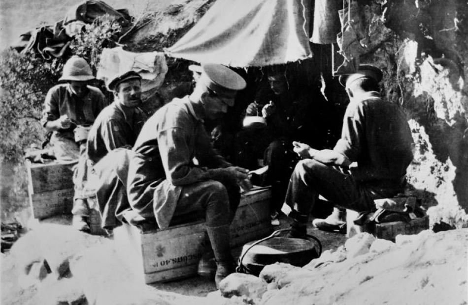 Soldiers relax at meal time.