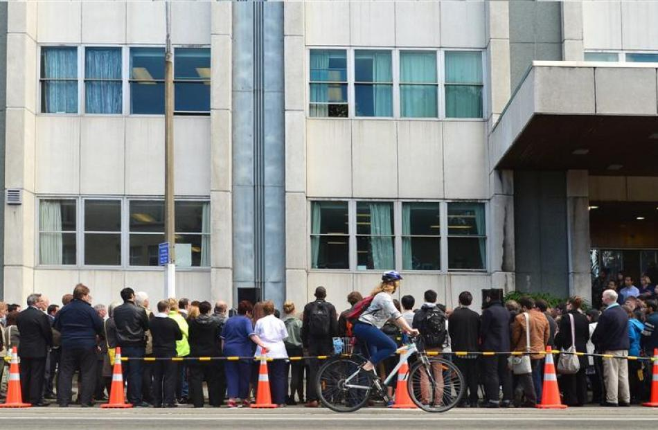 Some of the about 200 people who gathered in Cumberland St, outside Dunedin Hospital, yesterday...