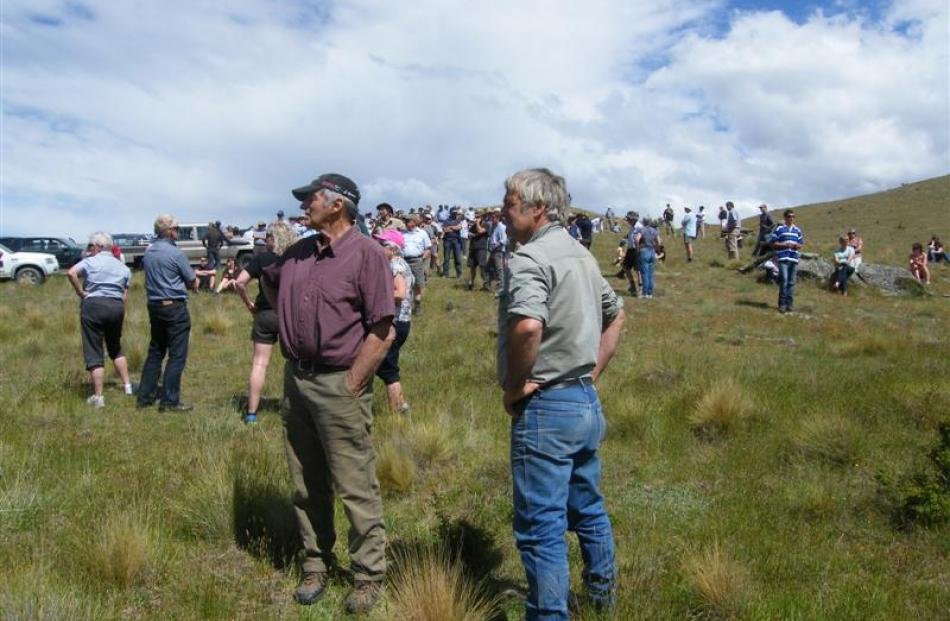 Some of the about 300 attendees of a field day at Earnscleugh Station look over the area in the...