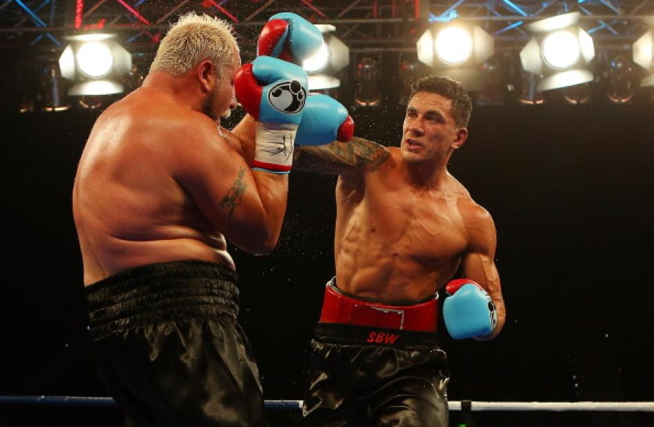 Sonny Bill Williams punches Francois Botha during their heavyweight bout at the Brisbane...