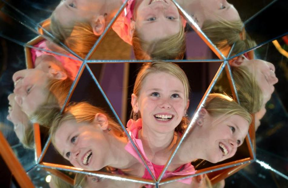 Sophie Warner, of Winton, takes a closer look at a Mirror Magic interactive exhibit at  Otago...