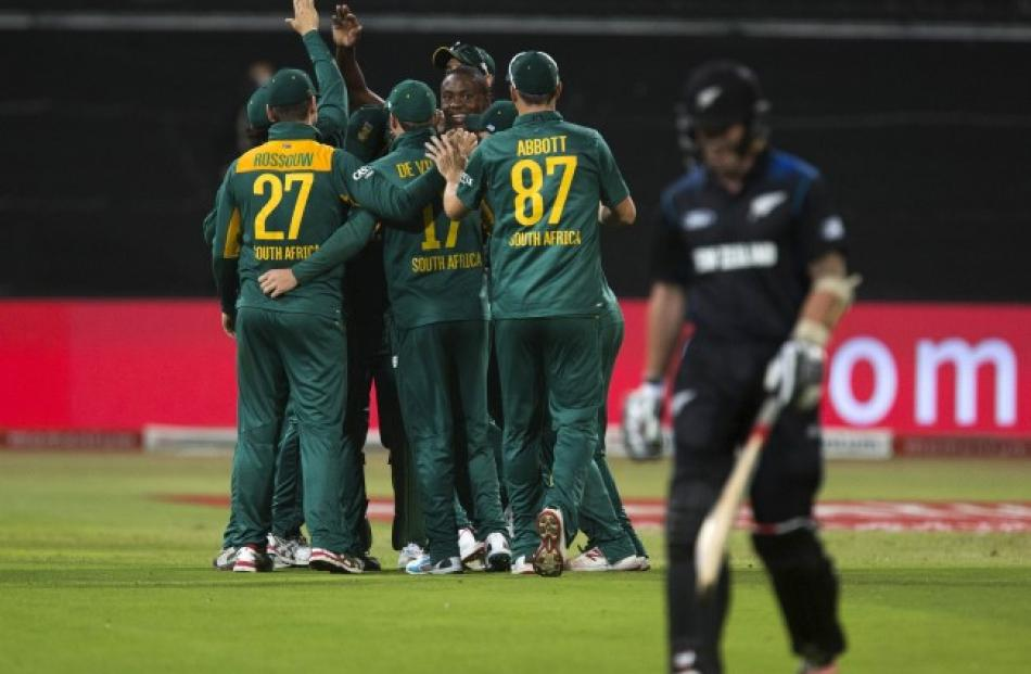 8f1159255fd South African players celebrate the dismissal of New Zealand s Luke Ronchi.  REUTERS Rogan Ward