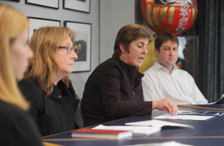 South Dunedin Business Association president Jane Orbell (second from left) listens as Dunedin...