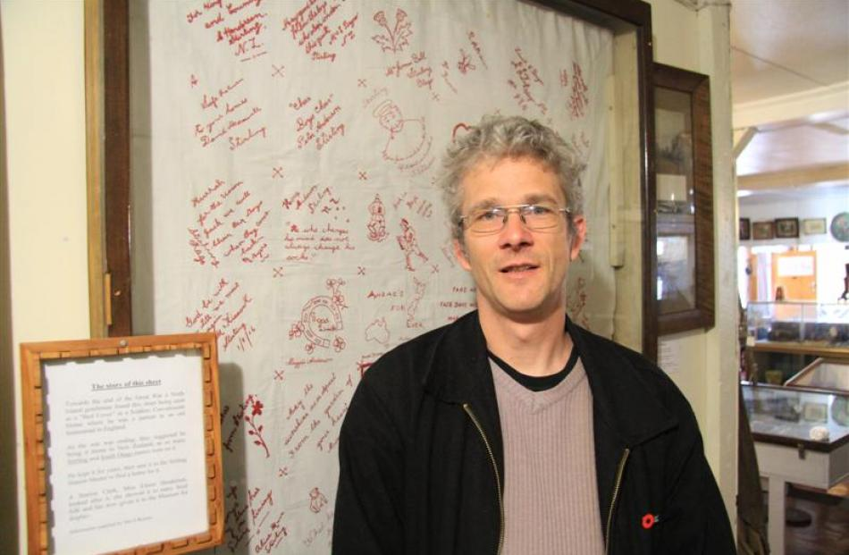 South Otago Museum curator Gary Ross says the Red Cross of Stirling's WW1 bed sheet recently...