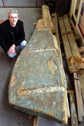 South Otago Museum curator Gary Ross with a rudder which may be related to an old anchor which...