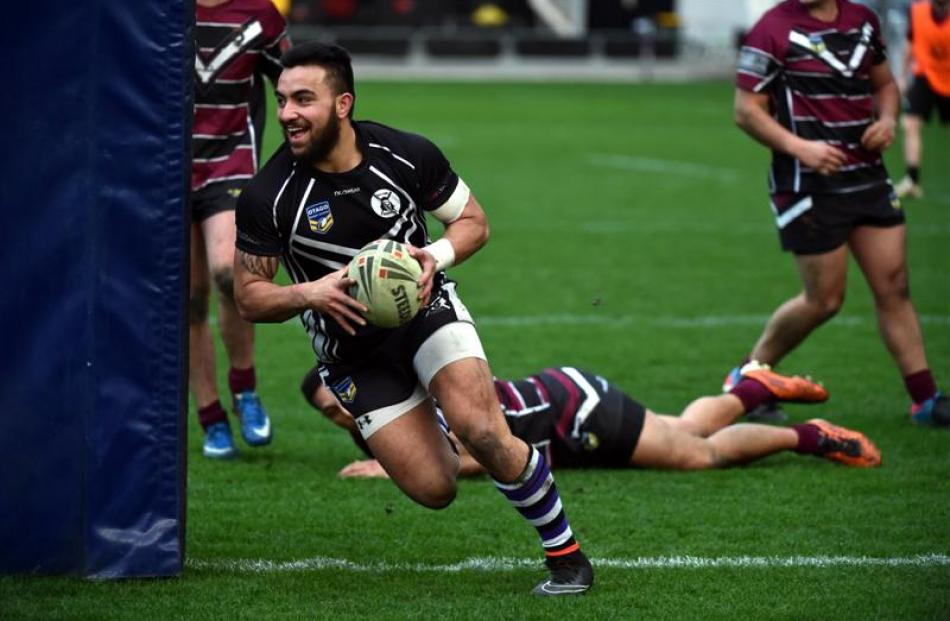 South Pacific Raiders hooker Isaac Misky rounds the post to score one of his two tries against...