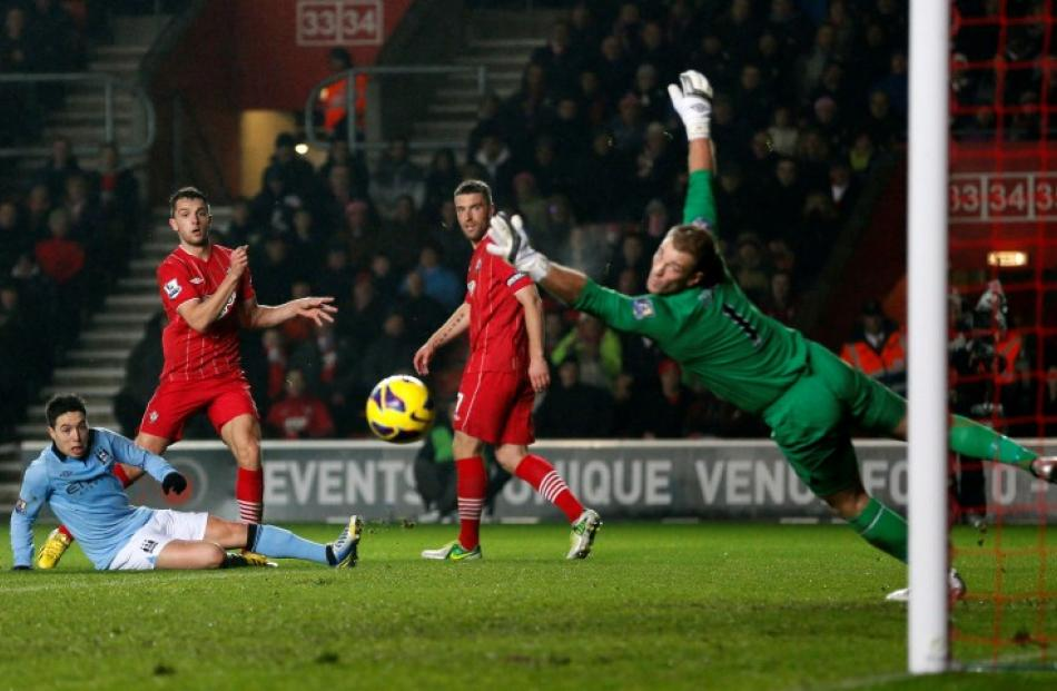 Southampton's Jay Rodriguez (2nd L) shoots but misses past Manchester City's goalkeeper Joe Hart...