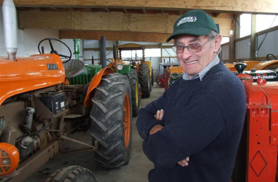 Southland farmer Mervyn Horrell with some of his 84-strong tractor collection. Photos by Sally Rae.