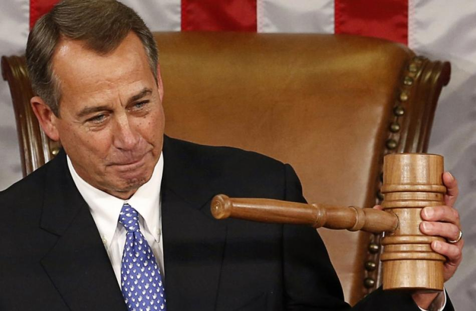 Speaker of the House John Boehner holds up the gavel after being re-elected on the first day of...