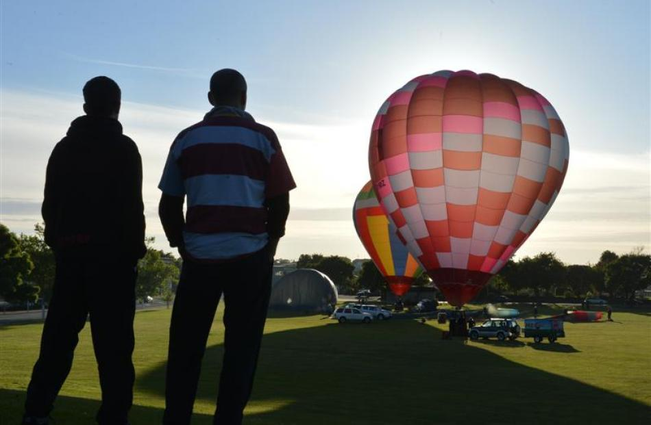 Spectators Watch As Colourful Balloons Are Inflated In Oamarus Awamoa Park Yesterday Morning