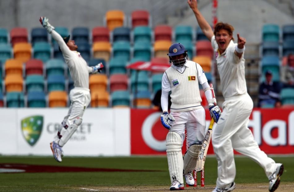 Sri Lanka's Tillakaratne Dilshan (centre) watches as Australia's Shane Watson (right) and...