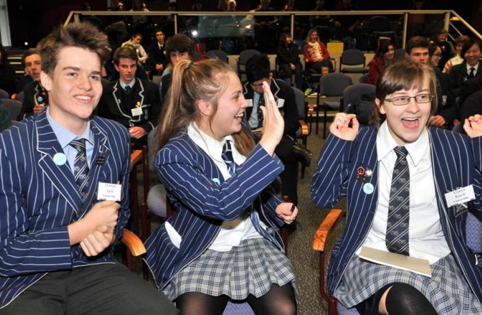 St Andrew's College (Christchurch) pupils (from left) Charles Reid, Isla Evison and Ellen Black ...