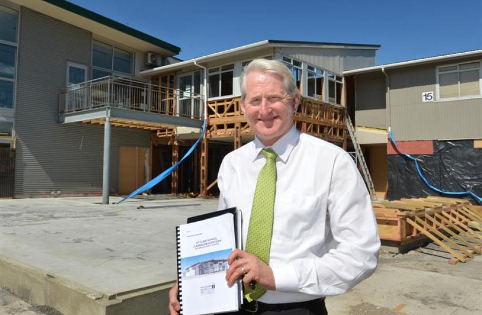 St Clair School principal Richard Newton in front of the foundations of the school's new four...