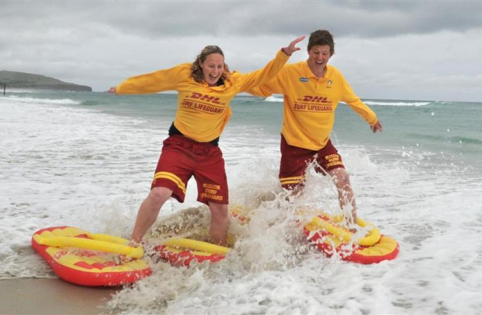 St Clair Surf Life Saving guards Steph Laughton (left) and James Rolfe take to the St Clair surf...