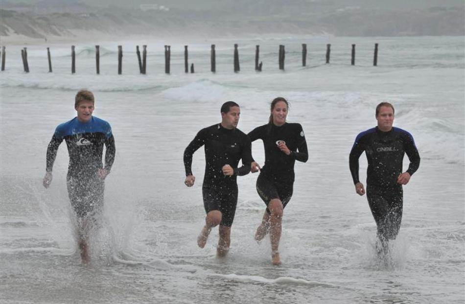 St Clair surf lifesavers train at St Clair yesterday (from left)  Angus Mackenzie (17), James...