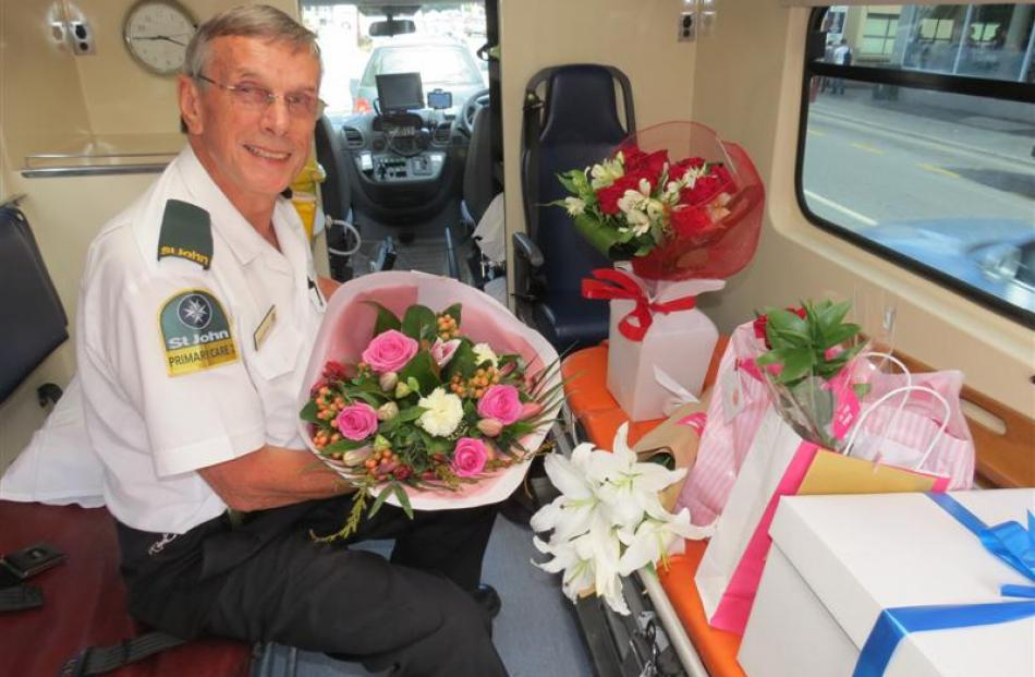 St John Queenstown ambulance officer Alex Taylor prepares his latest delivery of  Valentine's Day...